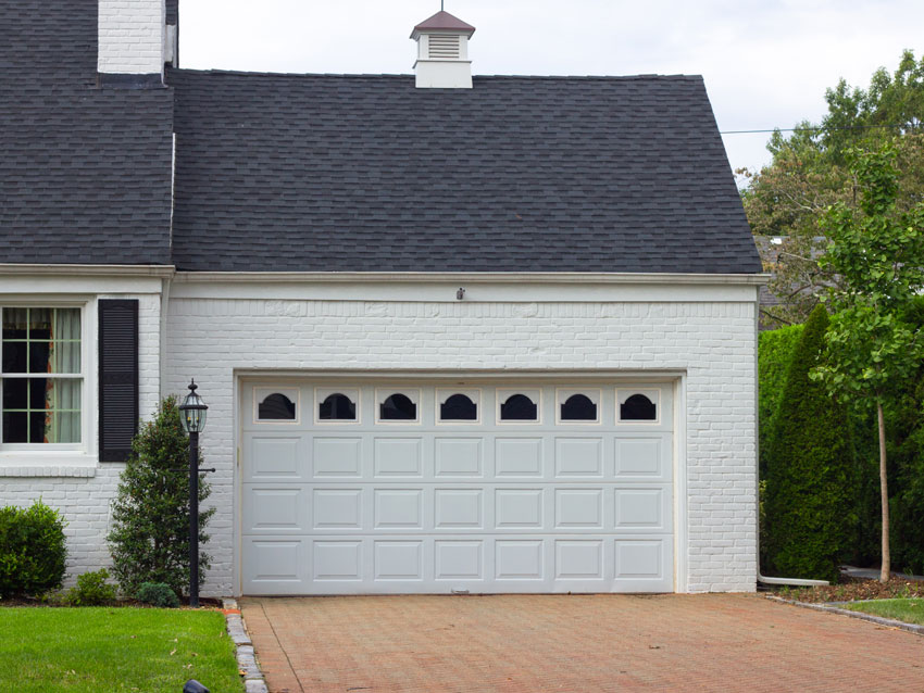 Add more value to your house! Install a new garage door before selling it.